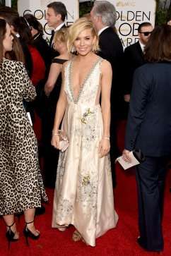 Sienna Miller in Miu Miu with Christian Loubotin clutch and Jimmy Choo shoes