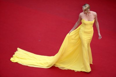 Charlize Theron in Christian Dior Couture and Chopard jewels - Courtesy of huffingtonpost.ca