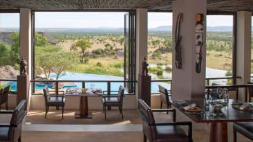 Four Seasons Safari Lodge Dining - Courtesy of Four Seasons Resorts