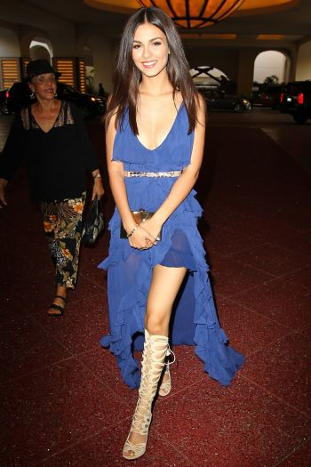 Victoria Justice in blue dress and tan lace up boots - Courtesy of hawtcelebs.com - The Luxe Lookbook