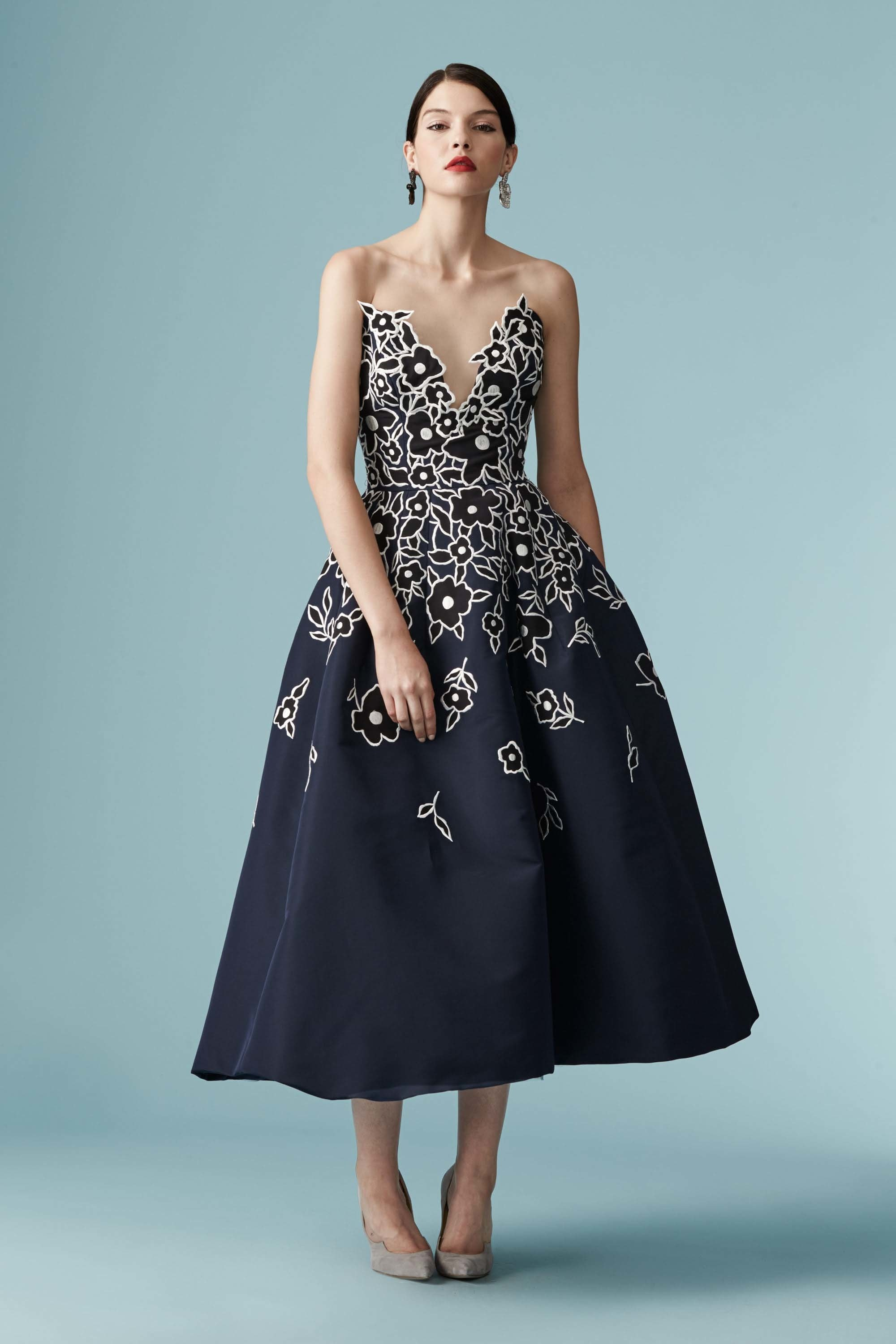 Model wearing Carolina Herrera midnight blue butterfly bustier fit-and-flare dress with floral appliques