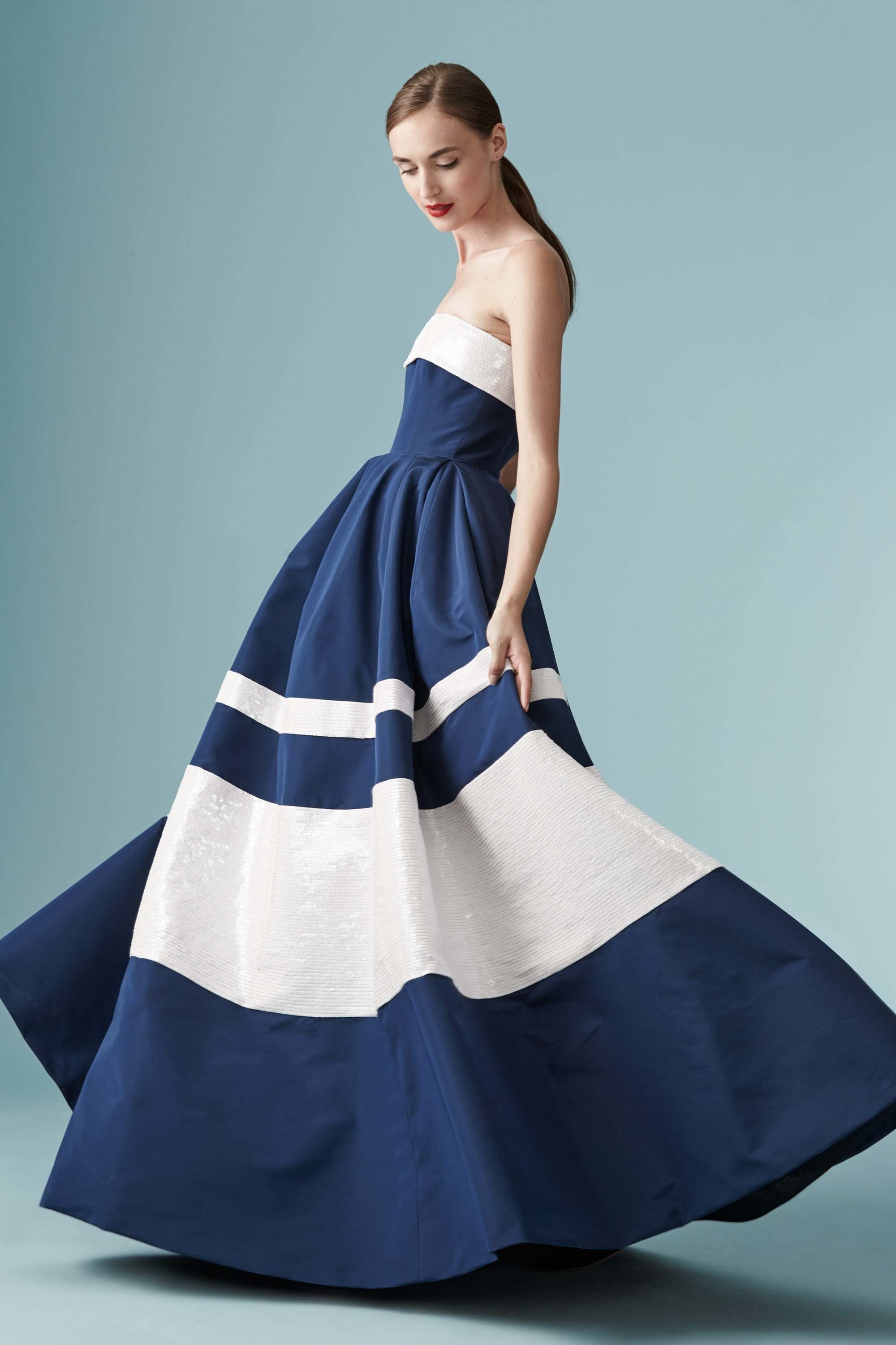 Model wearing Carolina Herrera blue and white striped gown